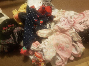 0-3 month old girl cloths and some size one diapers
