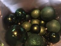 Christmas green baubles and tree decorations