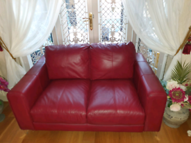 Red real leather 2 seater sofa