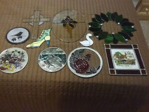 Stained glass window hangings.
