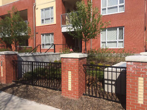 Kensington 2 bed/2 bath walkout townhome/condo with yard.
