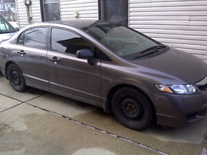 2009 Honda Civic DX-G Sedan $ 9,500.
