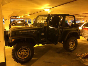 "1999 Jeep 4+4 36"" lift kit and tires. Extra parts"