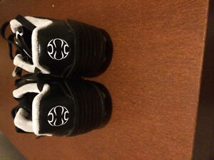 Black Adidas cleats : size 5