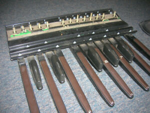 Old part from an electric organ.