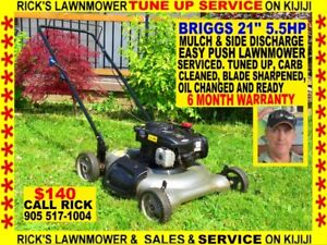 A 5 HP 21'' MTD BAG AND MULCH LAWNMOWER.EASY START,