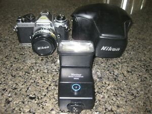 NIKON FE2 35mm Camera w/50 mm Lens, Flash, Manuals, Mint
