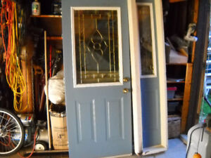 Metal Front Door with sidelight  Stained glass inserts.
