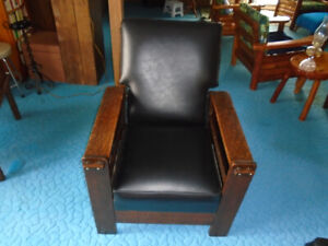 A beautiful antique chair and ottoman.