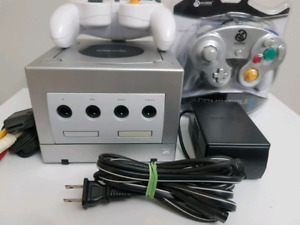 Platinum Gamecube system with hook ups and 1 game .
