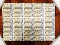 Uncut sheet from The Bank of Canada One Dollar Bills, Framed