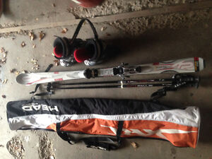 Skis, boots, poles and carrying bag