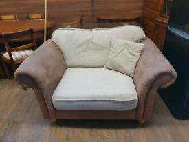 2. Cream and brown cuddler chair