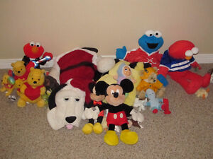 Group of Stuffies, Mickey Mouse, Elmo, Cookie Monster, etc