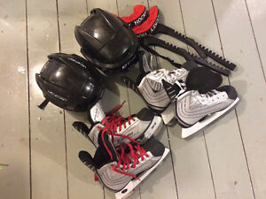 Boys hockey skates and helmets