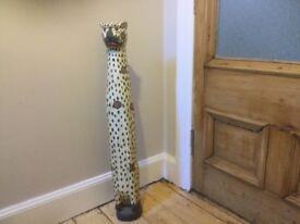 Tall wooden cat statue