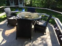 Patio table and 4 chairs   $50.00