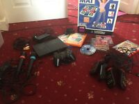 Ps2 slimline, controller, eye toy, dance mat, buzz controllers, sing star mics and games