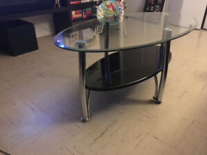 Round glass top table with black metal base $100