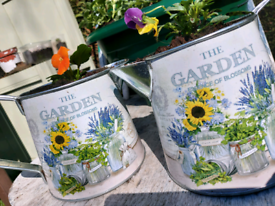 Cute small garden jugs with flowers