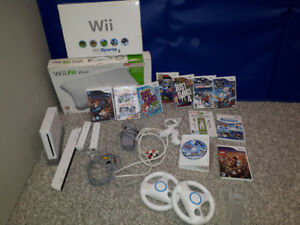 Wii, steering wheels, balance board, controllers and games