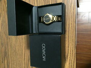 Brand new Movado watch and all Gold Necklace
