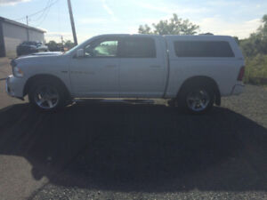 2012 Ram Sport . Leather , truck cap back up Cam. $9900.