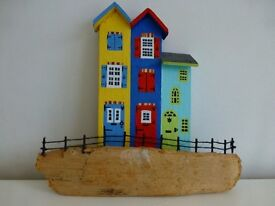 Drift wood painted houses by the sea