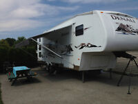 Denali 5th wheel with bunks and loft.