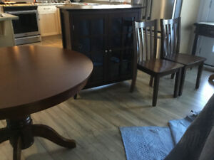 Table, chairs and china cabinet