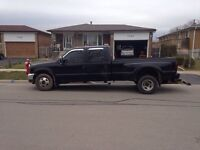 2003 Ford F-350 dually with a ratler wheel lift
