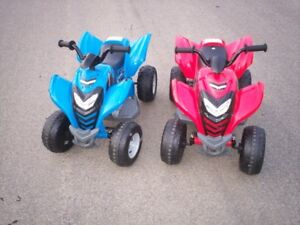 Pending Two toy battery run kid quads like new