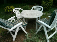 Well used patio furniture 4 chairs 1 table needs some love