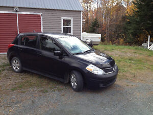 2007 Nissan Versa 1.8 S Hatchback, six speed manual transmission