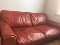 Red comfortable leather sofa.
