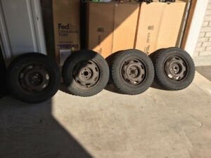 14 inch Honda Civic steel wheels with GoodYear Winter tires