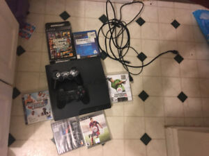 Ps3 with 2 controllers and lots of games