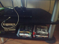 Ps3 slim with a stack of games.