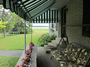 VIEW THE ST LAWRENCE FROM YOUR FABULOUS SUNROOM! Cornwall Ontario image 3