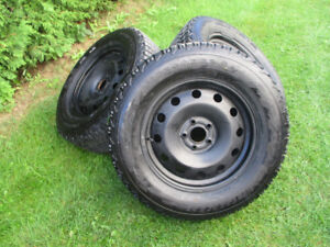 WINTER TIRES + RIMES 245/65/17 LIKE NEW  NEW