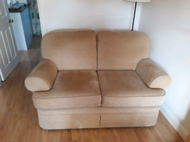 Sofa, armchairs and footstool.