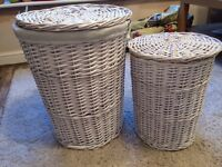 Two white wicker baskets