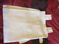Pair of IKEA floor length tab top cream curtains