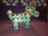Large dog made out of TANG boxes...