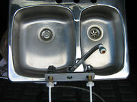 Double stainless steel sink with kitchen faucet