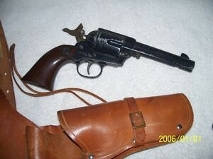Repilica Peacemaker BB pistol w/leather holster.  Non-working