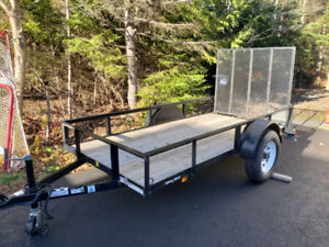 Like new 5' x 10' utility trailer.  Payload 2050 LBS.