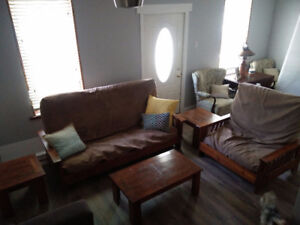 futon set with chair, end tables, and coffee table