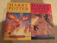 Two hard back Harry Potter books