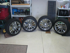 4 DAI CHROME & BLACK RIMS HERCULES RAPTIS RT-5 TIRES